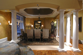 Just To The Left Of Front Entry Is Formal Dining Room Set Off From Rest Main Floor By Multiple Columns And An Octagonal Tray Ceiling