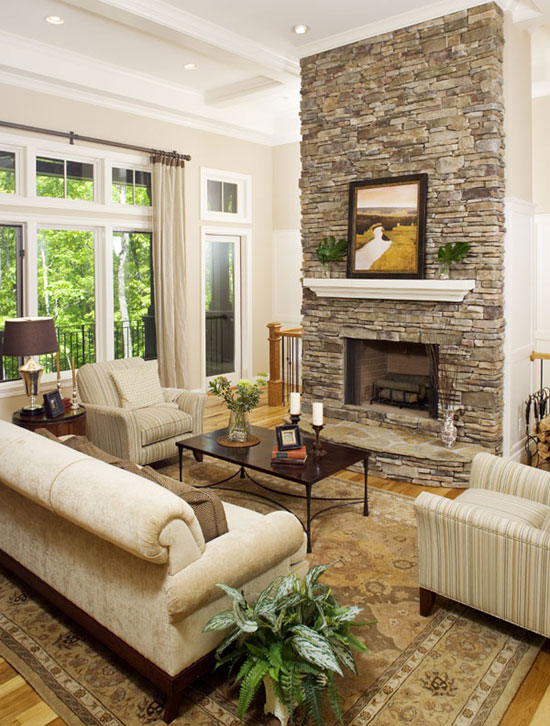 The Great Room Is Warmed By A Stone Fireplace Which Divides Staircase To Lower Level