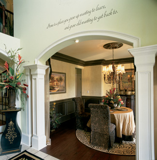 Columns And An Arch Set Off The Entrance To Formal Dining Room