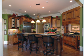 The Angled Kitchen Has Warmtoned Cabinets And An Island In Contrasting Wood That Separates The Prep Area From The Adjacent Breakfast Nook And Keeping Room